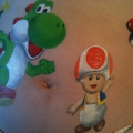 Bellypainting Yoshi en Toad www.sminkies-events.com